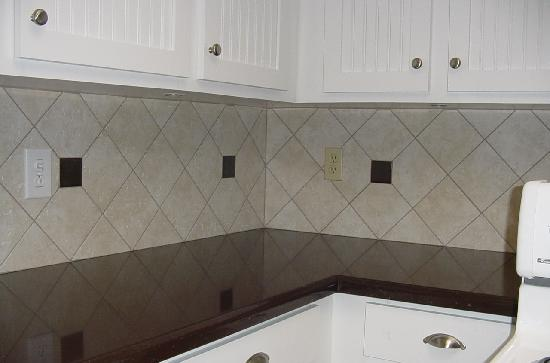 6x6 ceramic on diagonal with cut in decos to match counter top